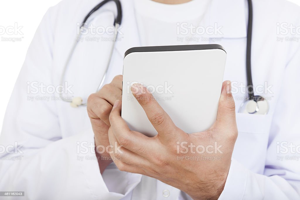 Doctor Using Digital Tablet stock photo