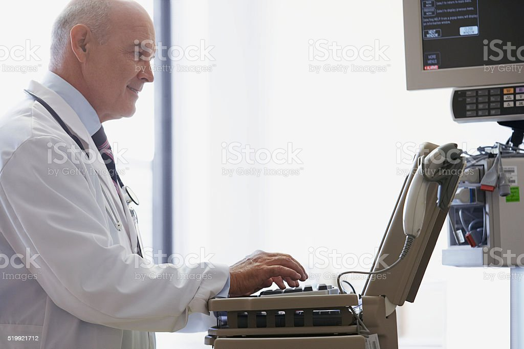 Doctor using medical equipment stock photo