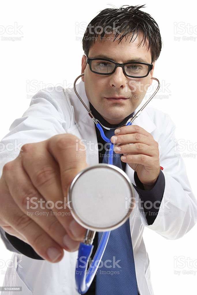 Doctor using stethoscope stock photo