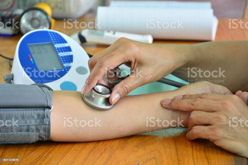 Doctor using stethoscope with patient for have a check-up stock photo