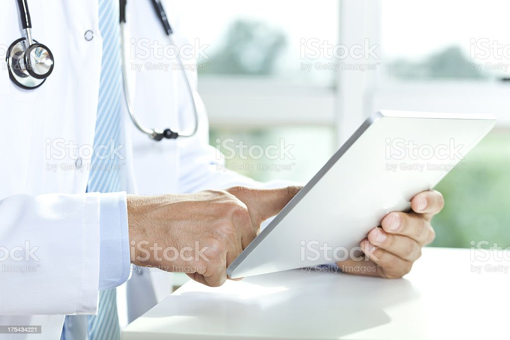doctor using tablet royalty-free stock photo
