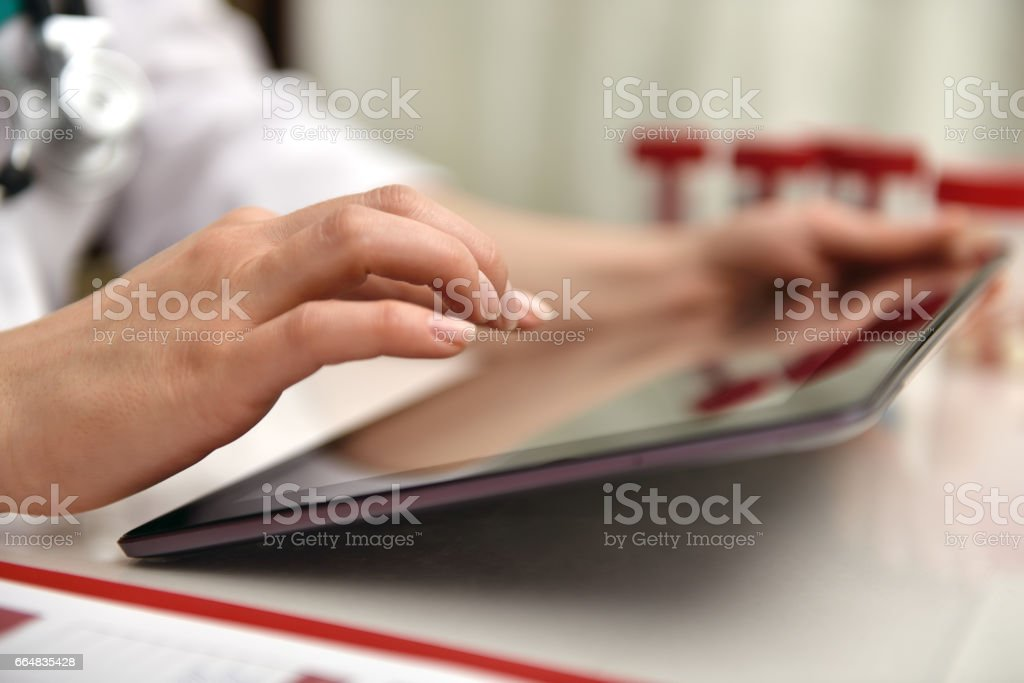 Doctor Using Tablet stock photo