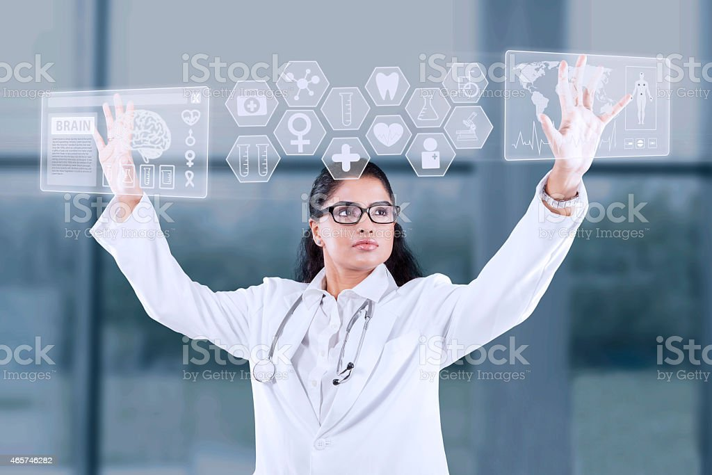 Doctor using touch screen interface stock photo