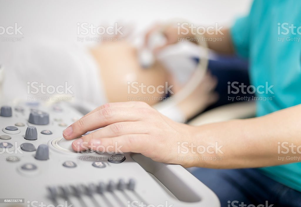 Doctor using ultrasound machine stock photo