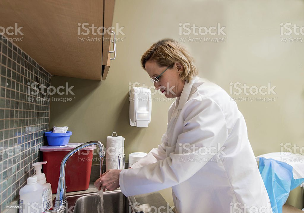 Doctor Washing Her Hands stock photo