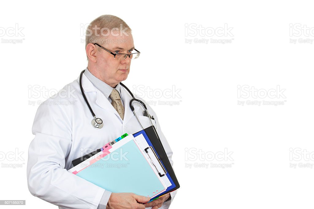 Doctor wearing glasses and stethoscope carrying some patient rec stock photo