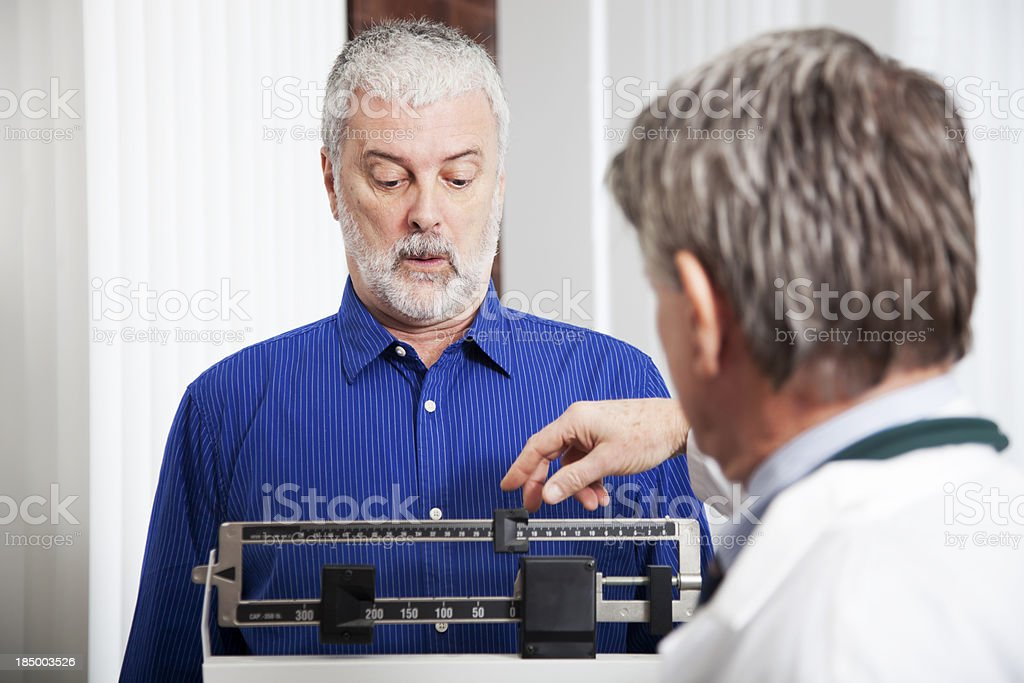 Doctor Weighing Patient stock photo