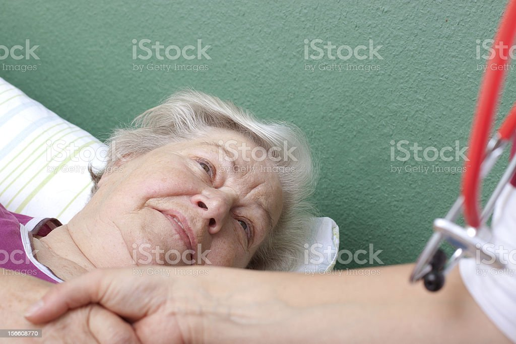 Doctor welcomes patient lying in bed royalty-free stock photo