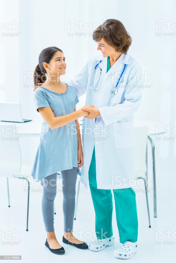 Doctor welcoming little patient royalty-free stock photo