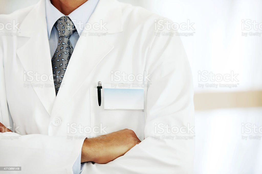 Doctor with a blank name tag. stock photo