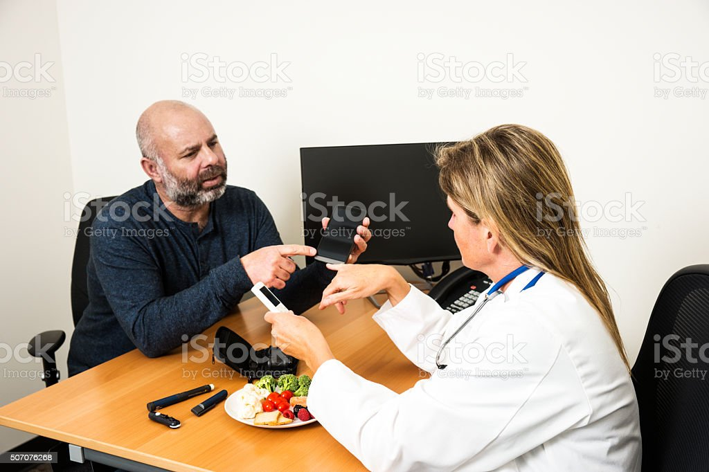 Doctor with a diabetes patient stock photo