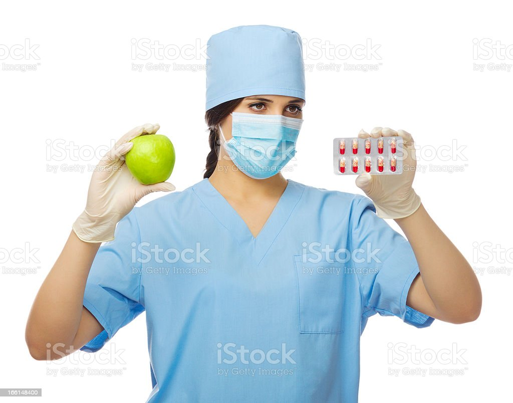 Doctor with apple and pills stock photo