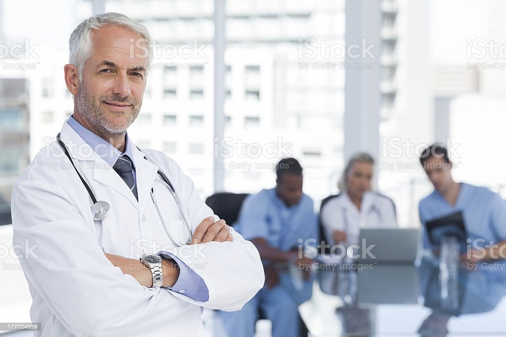 Doctor with arms folded stock photo