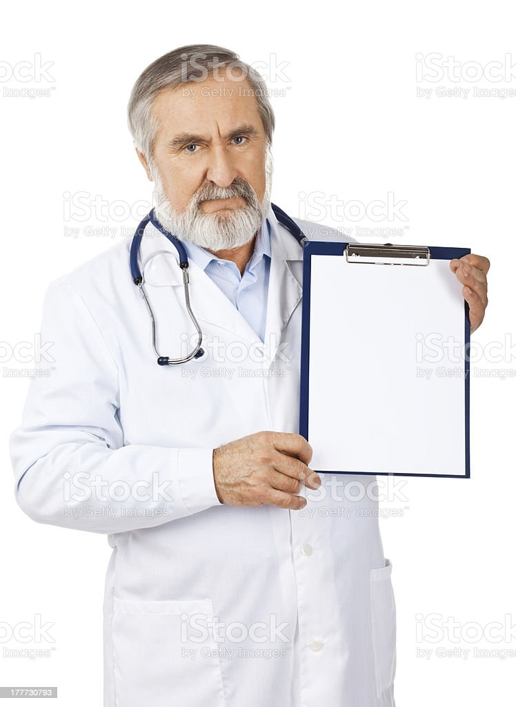 Doctor with blank sign on clipboard royalty-free stock photo