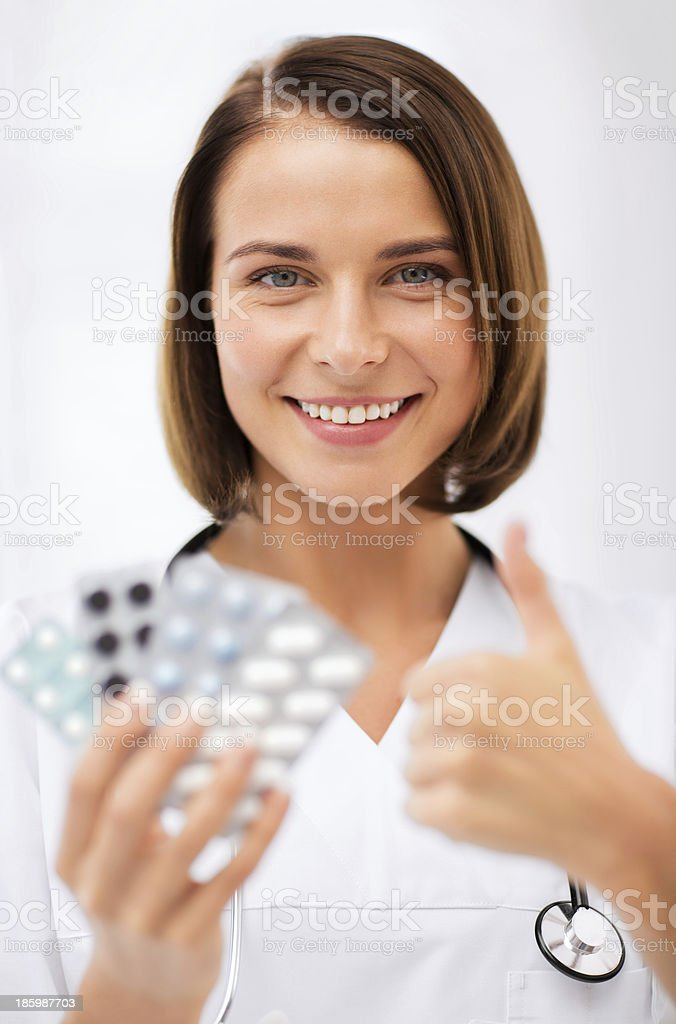 doctor with blister packs of pills royalty-free stock photo