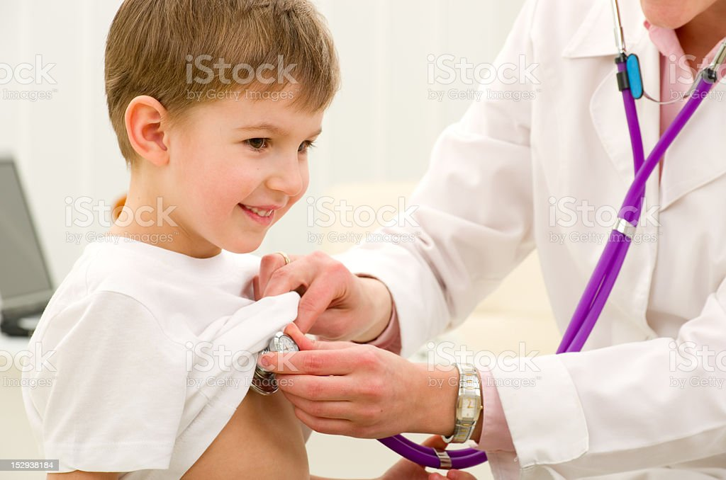Doctor with boy stock photo