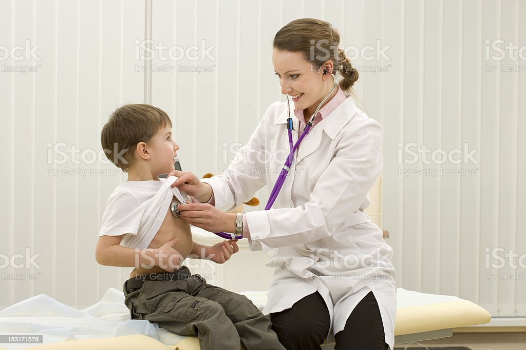 Doctor with boy royalty-free stock photo