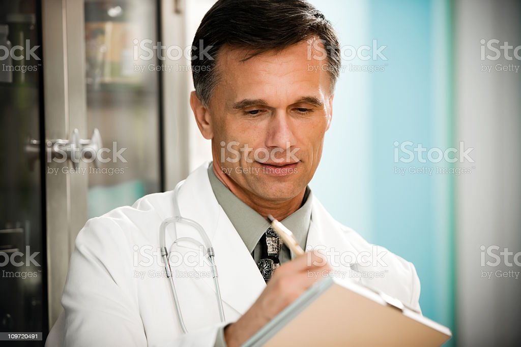 Doctor with clipboard and pen stock photo