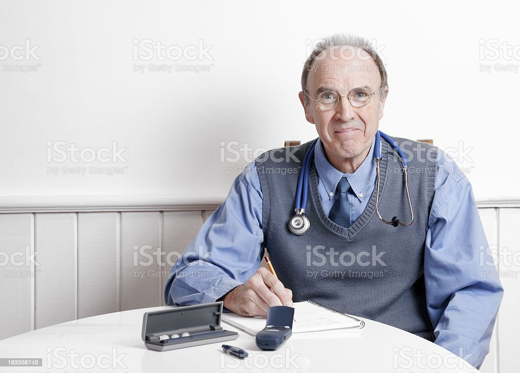 Doctor with diabetes testing devices royalty-free stock photo