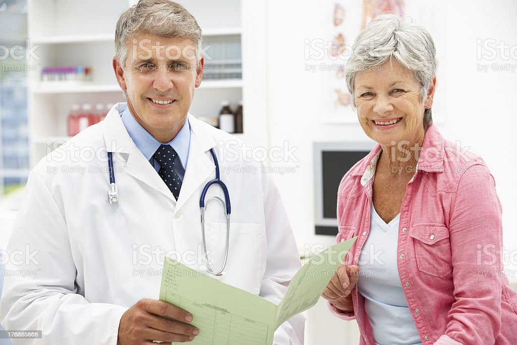 Doctor with female patient royalty-free stock photo