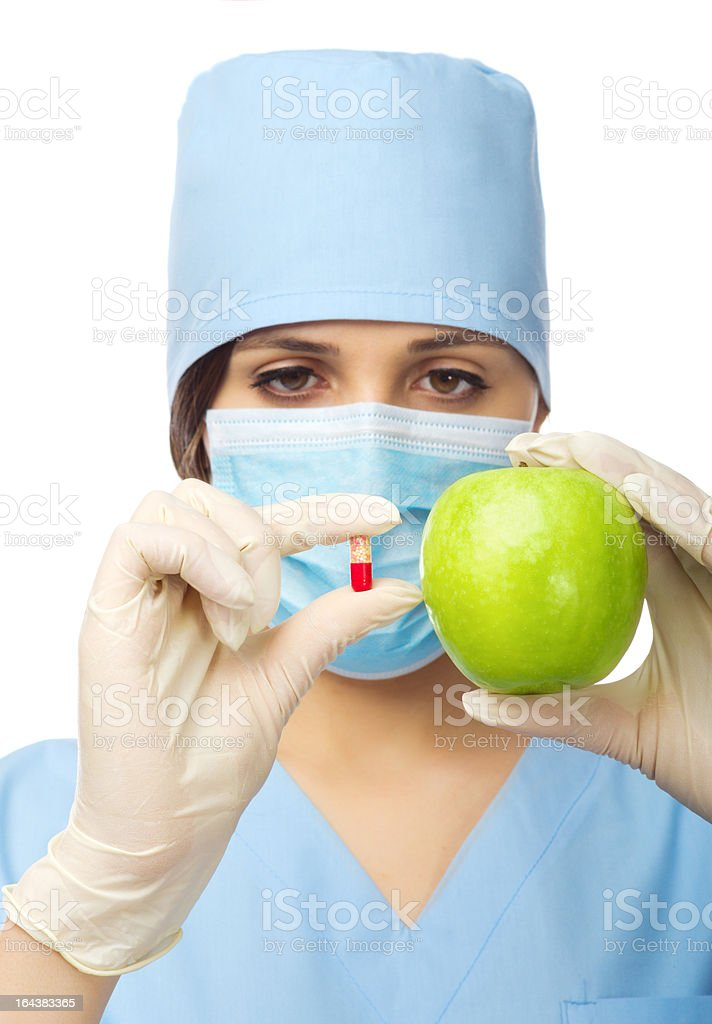 Doctor with green apple and pill stock photo