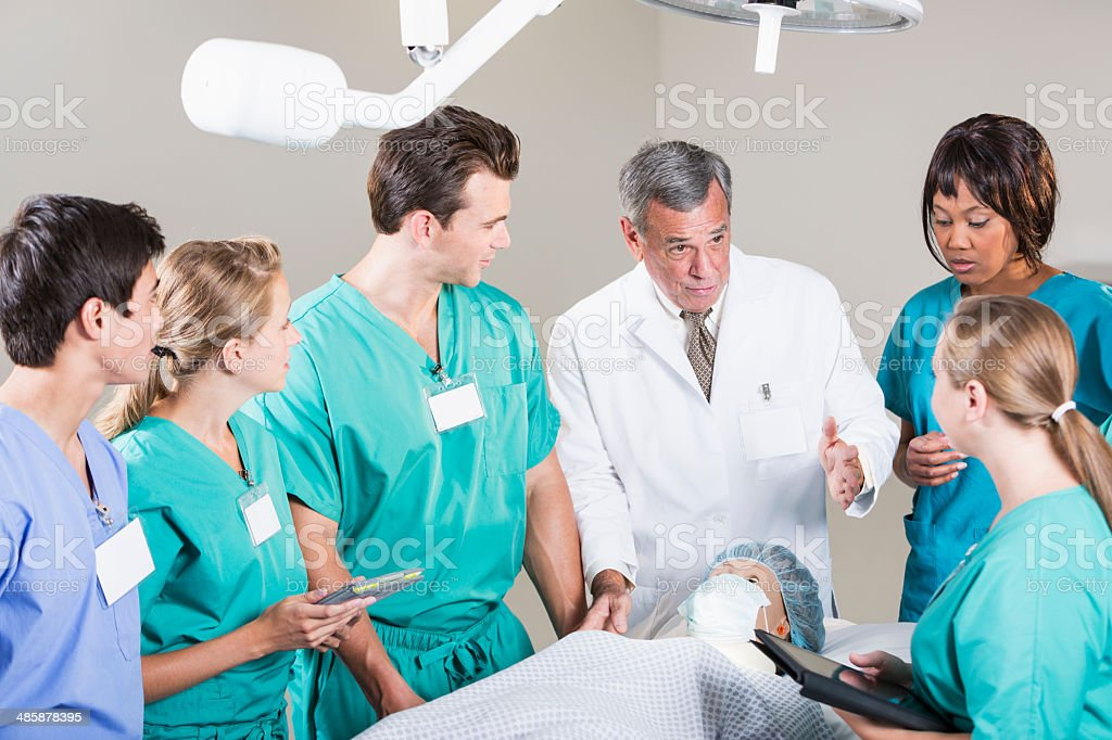 Doctor with group of medical students stock photo