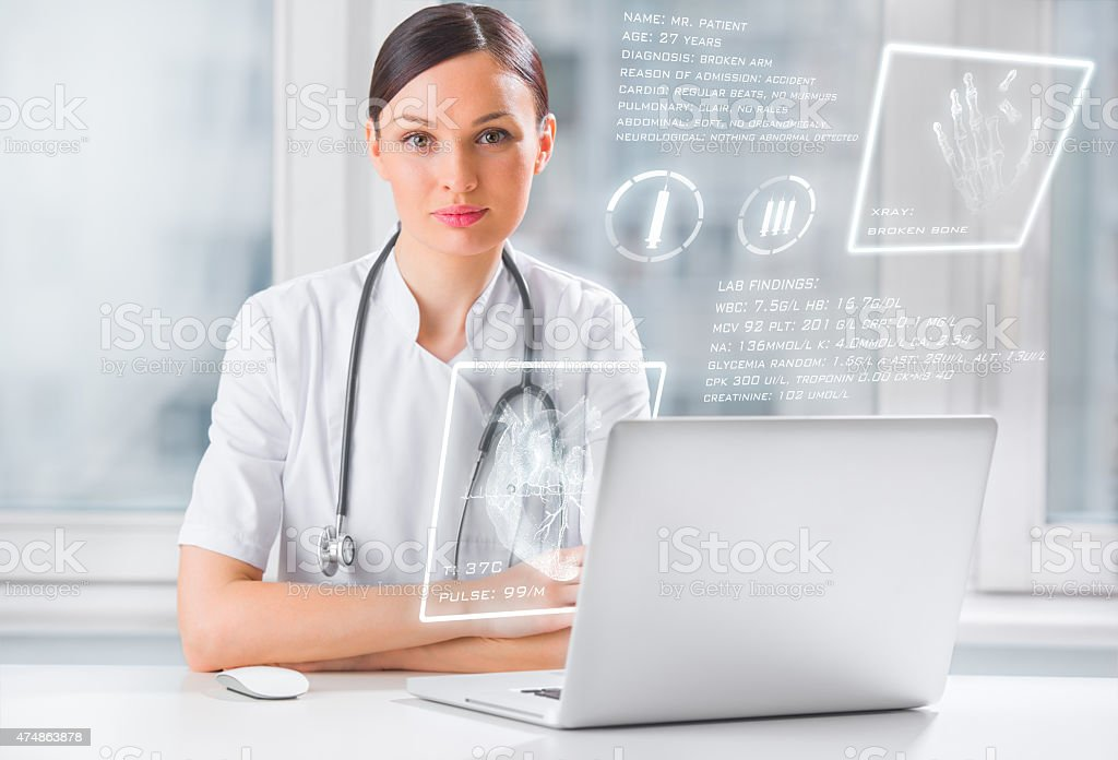 Doctor with hightech computer screen viewing patient data stock photo