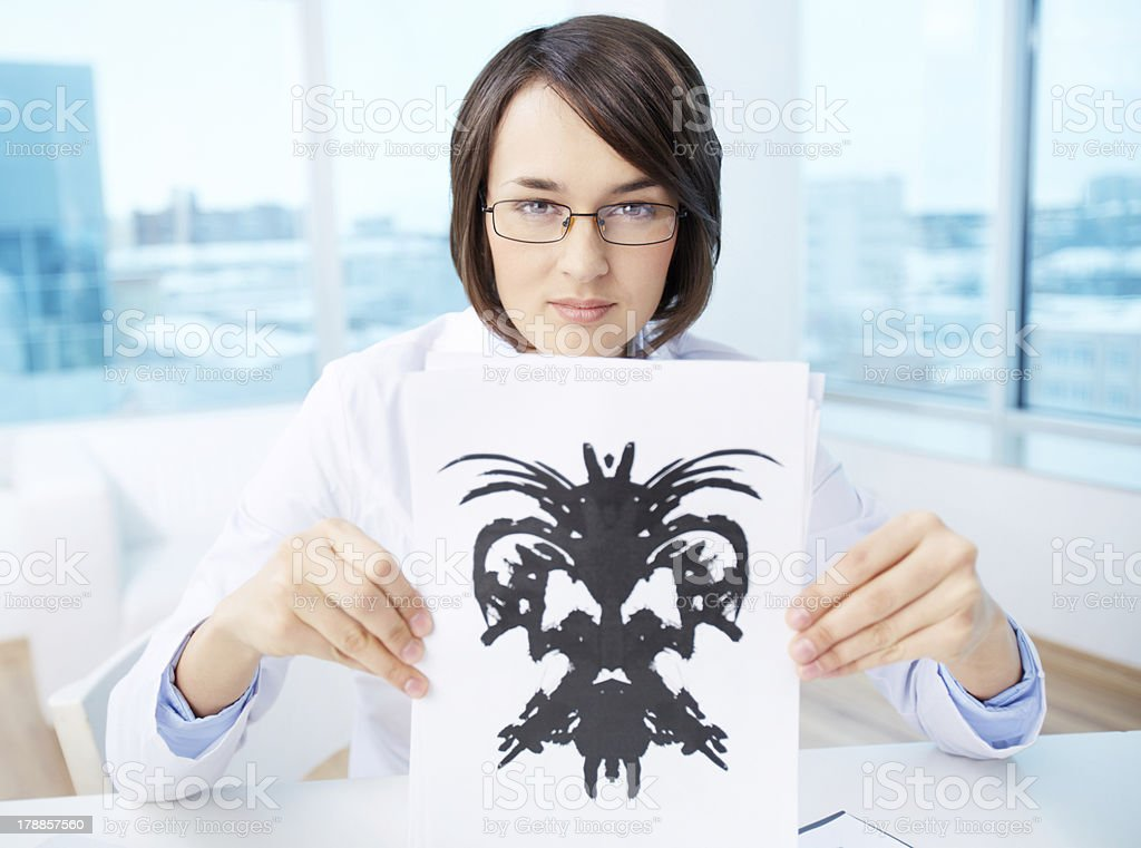 Doctor with inkblot royalty-free stock photo