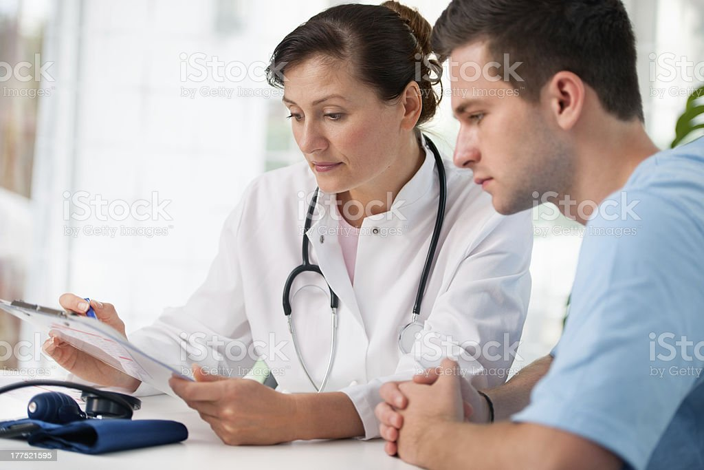 doctor with male patient royalty-free stock photo