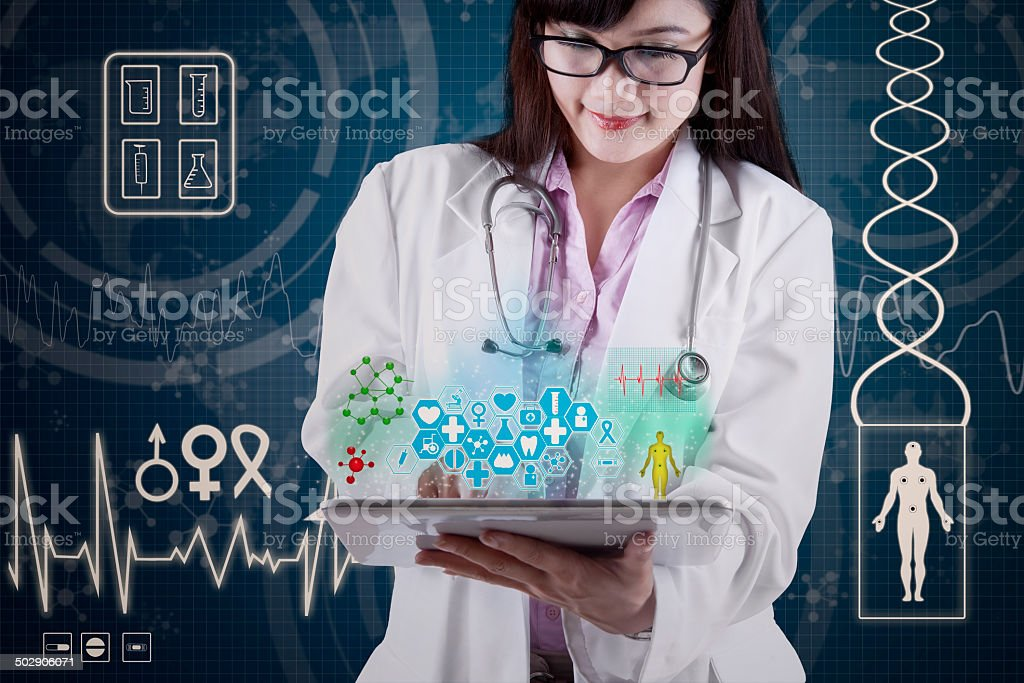 Doctor with medical apps on digital tablet stock photo