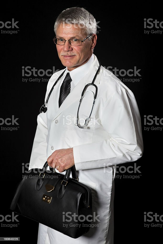 Doctor with medical bag stock photo