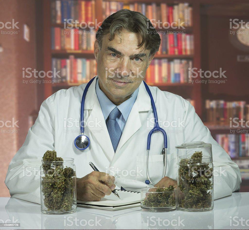 Doctor with medical marijuana stock photo