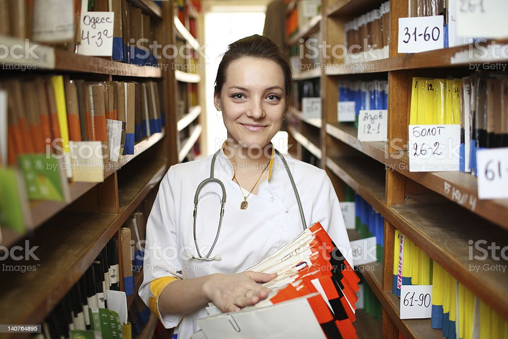 Doctor with medical records stock photo