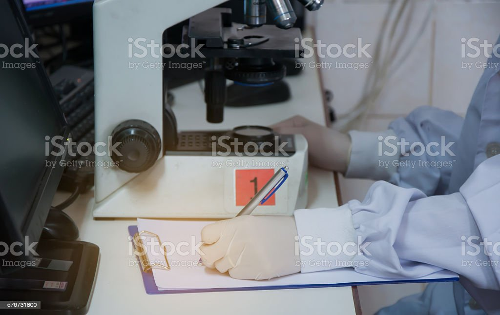 Doctor with microscope in laboratory. Scientific research stock photo