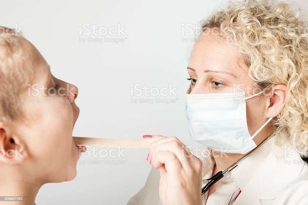 Doctor with mouth protection stock photo
