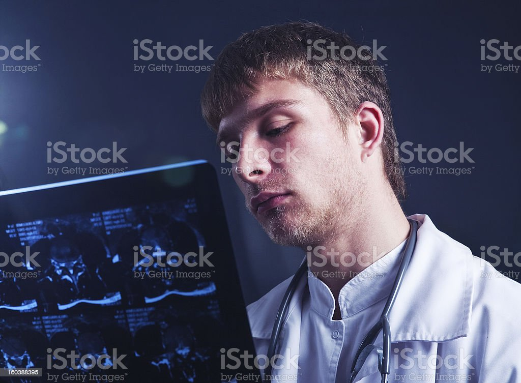 Doctor with MRI scan stock photo