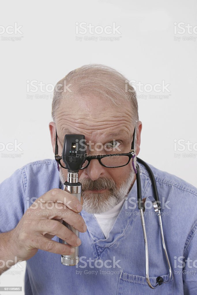 doctor with ophthalmoscope stock photo