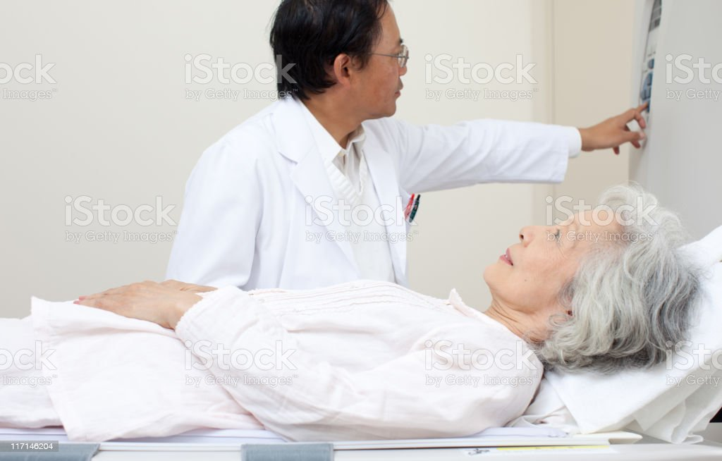 Doctor with patient at the MRI scaner royalty-free stock photo