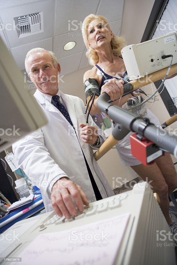 Doctor With Patient During Health Check royalty-free stock photo