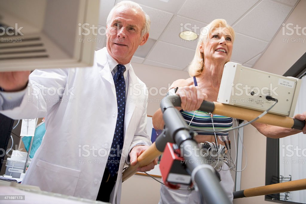 Doctor with patient during health exam royalty-free stock photo