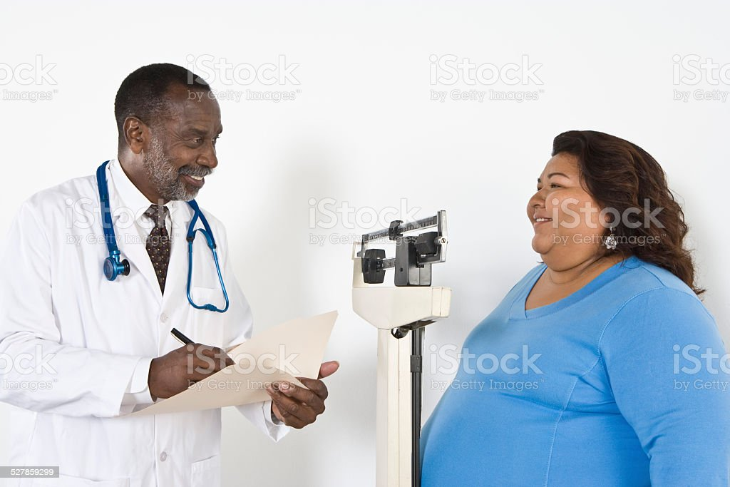 Doctor with patient stock photo