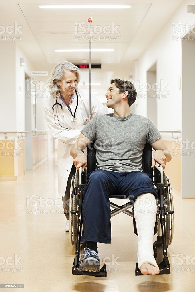 Doctor with recovering patient stock photo