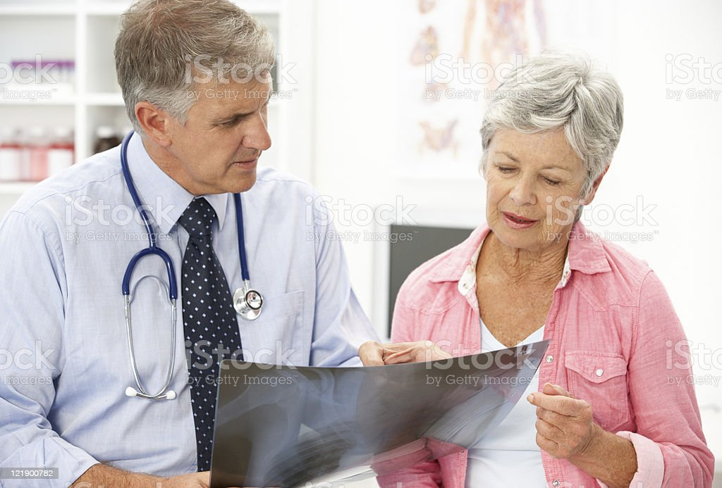 Doctor with senior female patient royalty-free stock photo