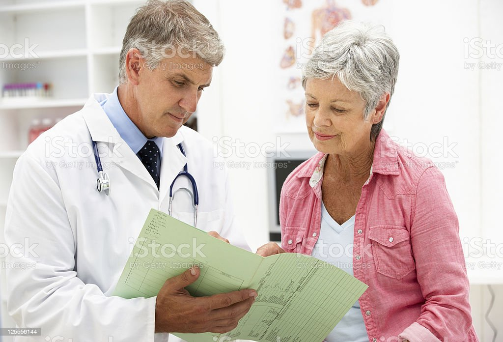 Doctor with senior female patient stock photo