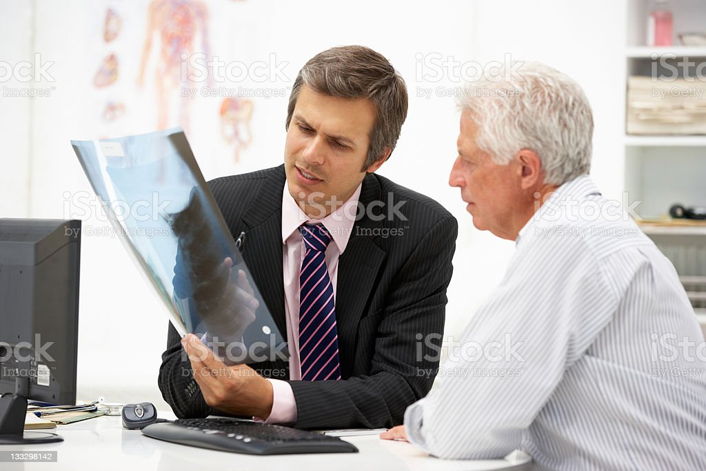 Doctor with senior patient royalty-free stock photo