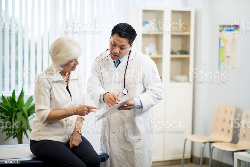 Doctor with Senior Patient stock photo