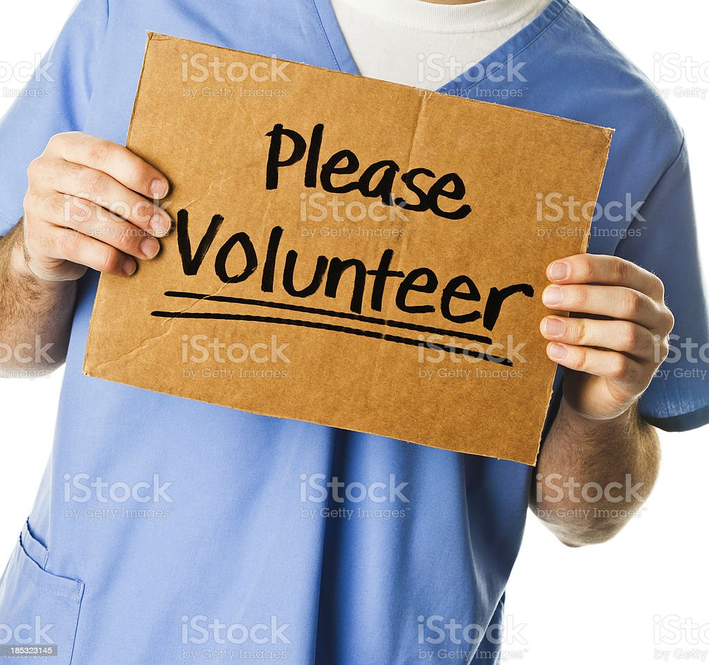 Doctor with Sign: Please Volunteer stock photo