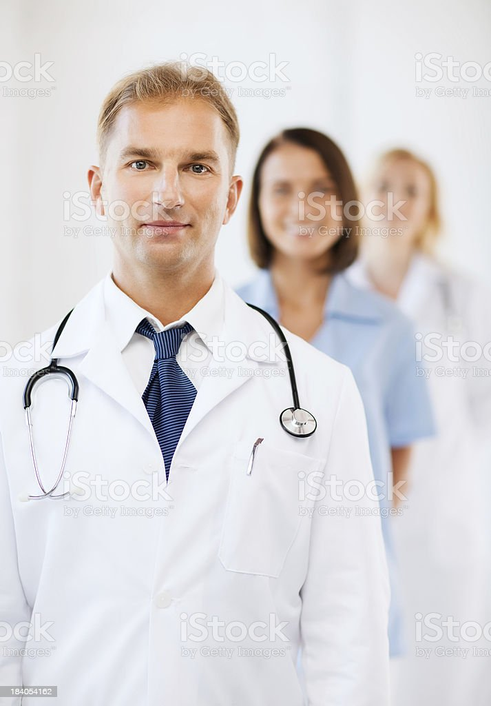 doctor with stethoscope and colleagues royalty-free stock photo