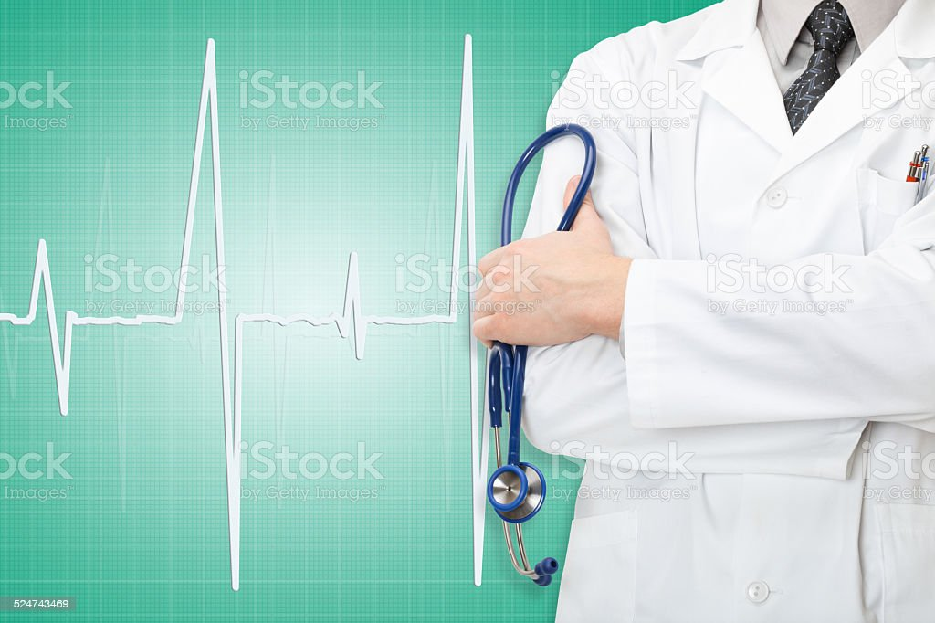 Doctor with stethoscope in hand and electrocardiogram on green background stock photo