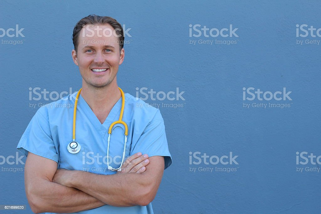 Doctor with stethoscope standing , crossed arms stock photo
